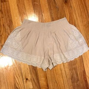 Cream flowy shorts